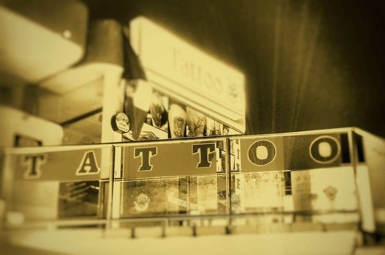 "A sign outside a tattoo parlor in Playa Del Carmen that reads ""TATTOO"" in big letters."