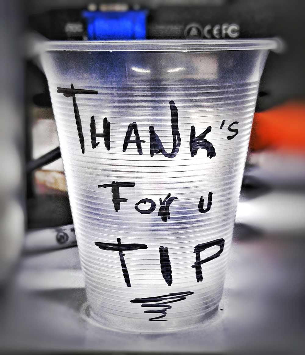 A tip cup that was on the counter of a liquor store in Playa Del Carmen.