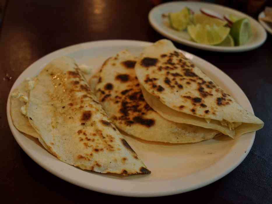 A side view of the quesadillas that my mom ordered at El Fogon.