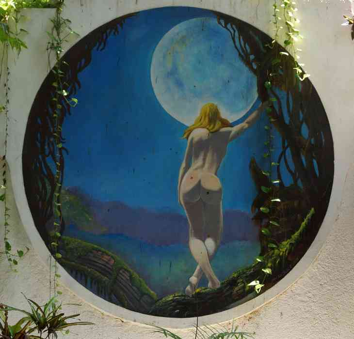 Painting of a woman looking at the moon at the Luna Blue Hotel.