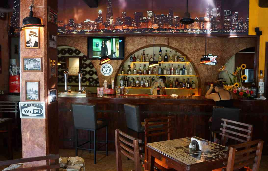 A bar with the Chicago skyline inside the Chicago Beef restaurant in Playa Del Carmen.
