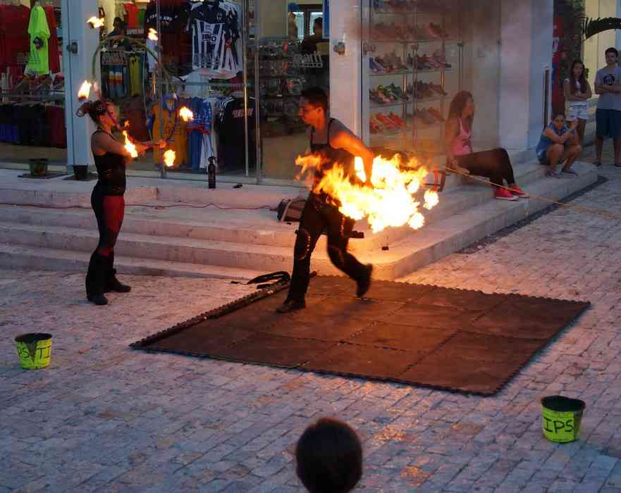 Several fire dancers trying to burn down the entire city of Playa Del Carmen.