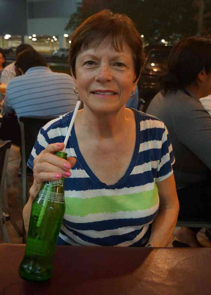My mom drinking a Sprite at El Fogon restaurant in Playa Del Carmen.