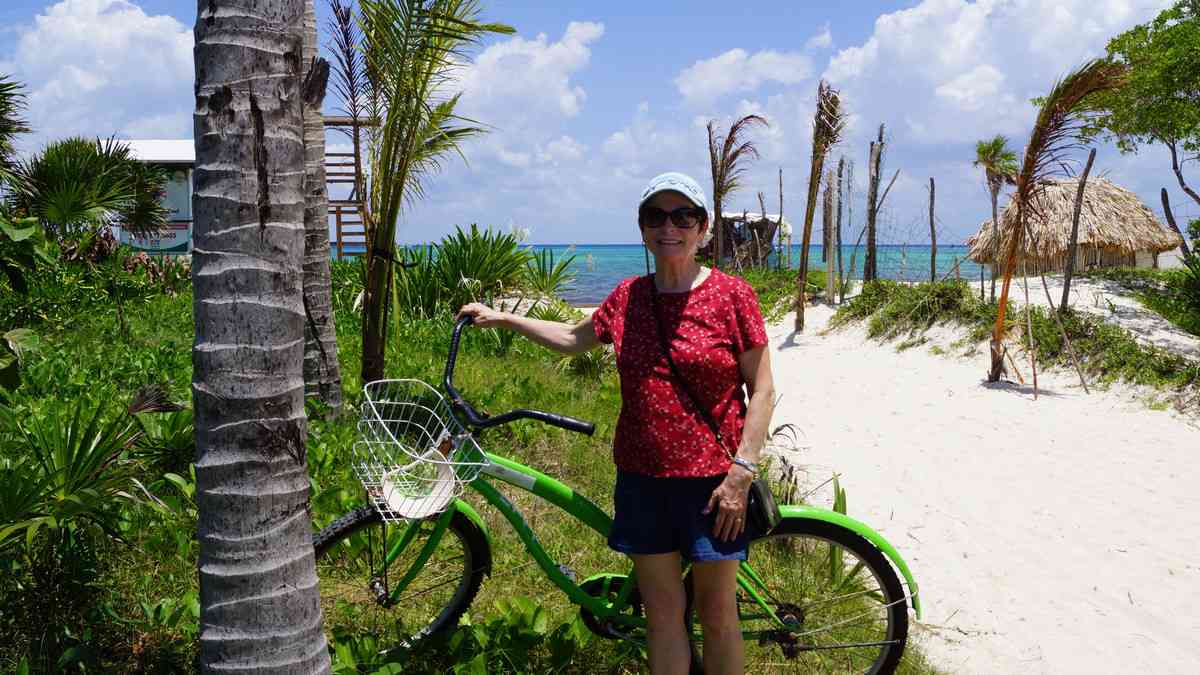 My mom on a beach path in Playa Del Carmen with her rental bike.