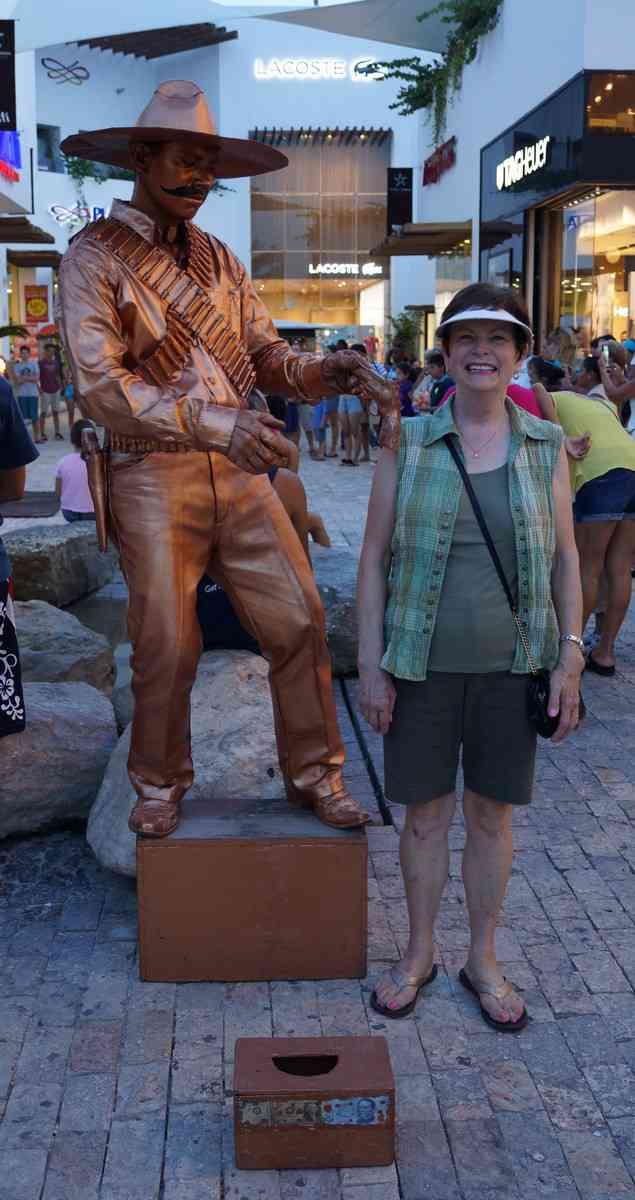 My mom preparing to punch the statue man holding a gun to her head.