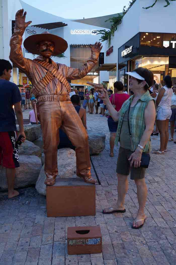My mom seriously thinking about shooting the statue man on Fifth Avenue in Playa Del Carmen.