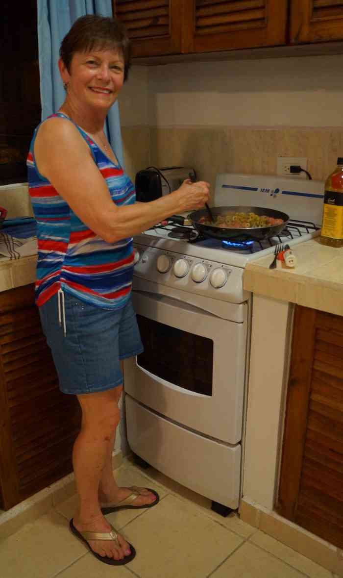 My mom stirring some spaghetti sauce that we made in the Luna Blue Hotel kitchenette.
