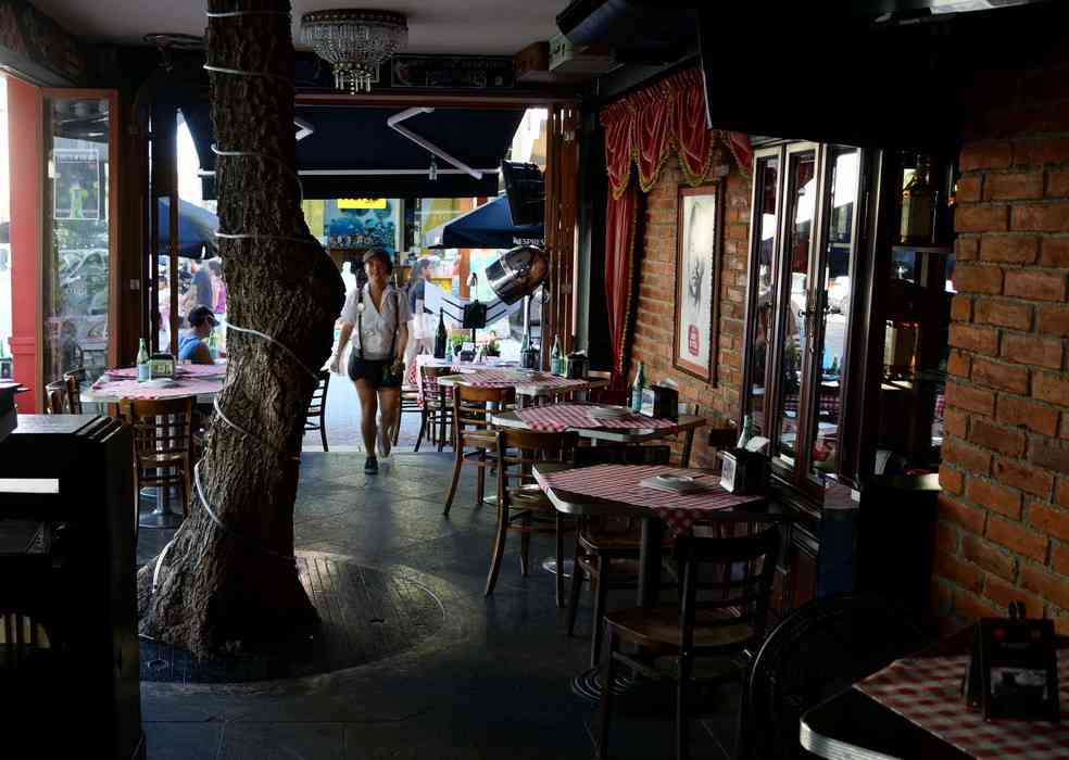 A view of part of the dining room that is spilling into the street at Lucky Luciano pizza restaurant in Playa Del Carmen.