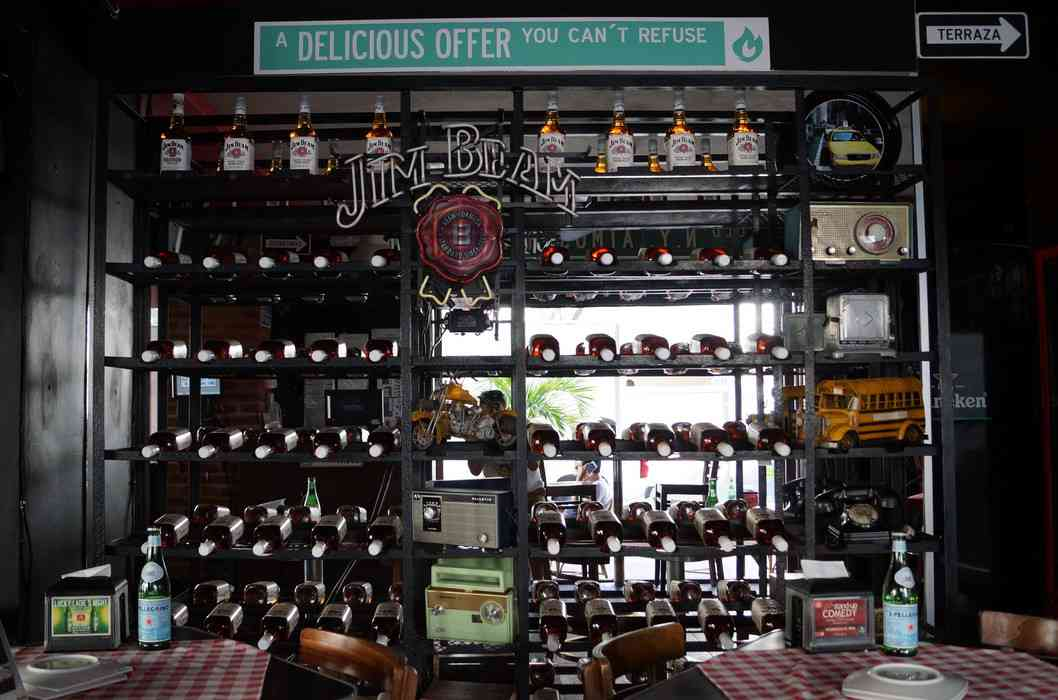 Several racks of Jim Beam bottles at the Lucky Luciano restaurant in Playa Del Carmen.
