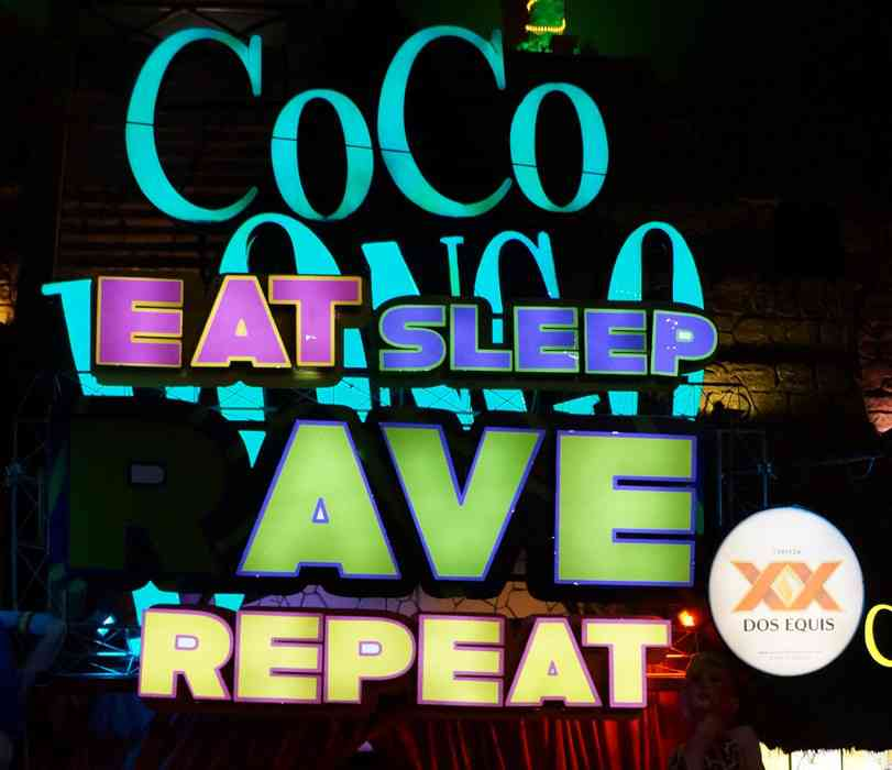 A large sign outside of the Coco Bongo nightclub.