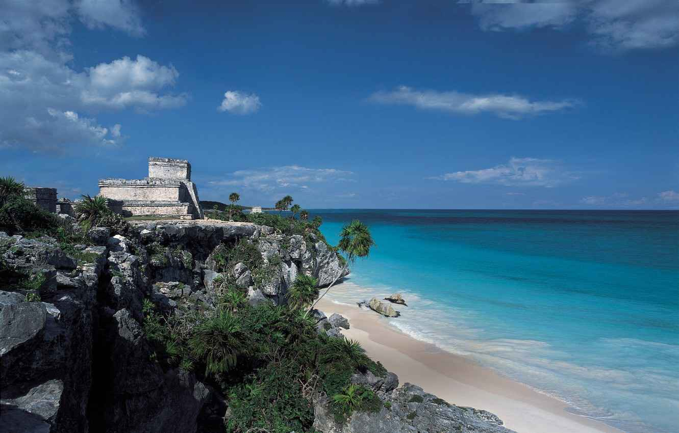A second side view picture of the Mayan ruins near the beach.