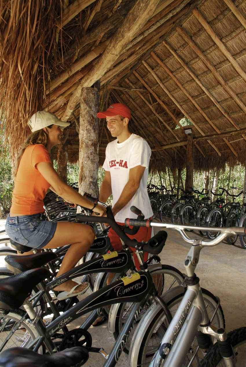 A man and a woman at a bike rental location.