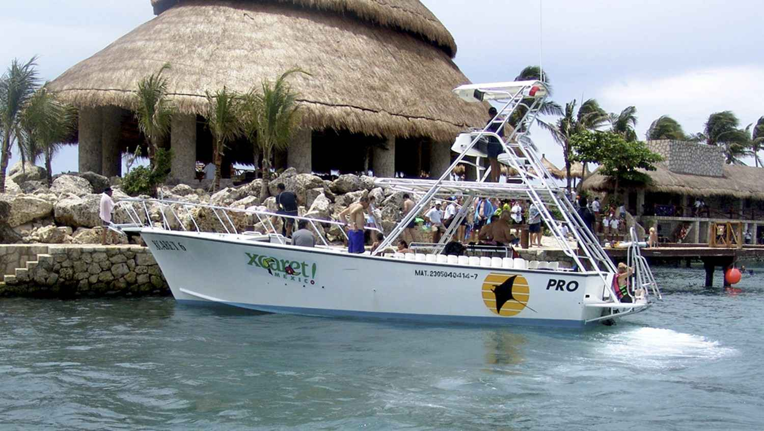 A scuba diving and snorkeling boat trolling past the shore of Xcaret.