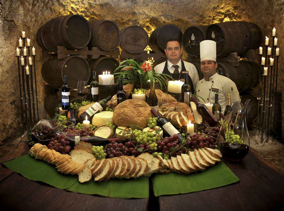 A table with food inside the winery at Xcaret.