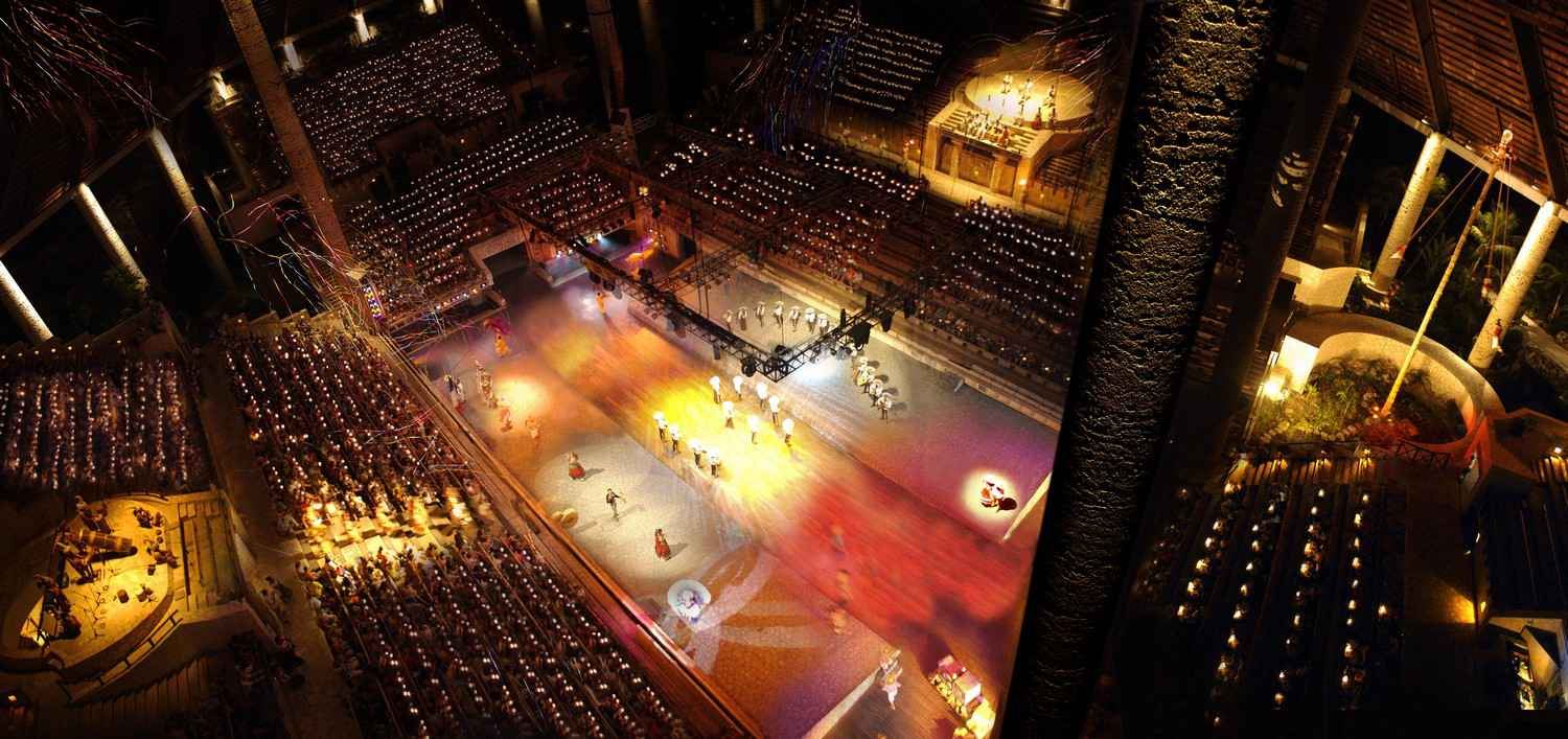 A traditional dance and ritual performance in the Xcaret Stadium.