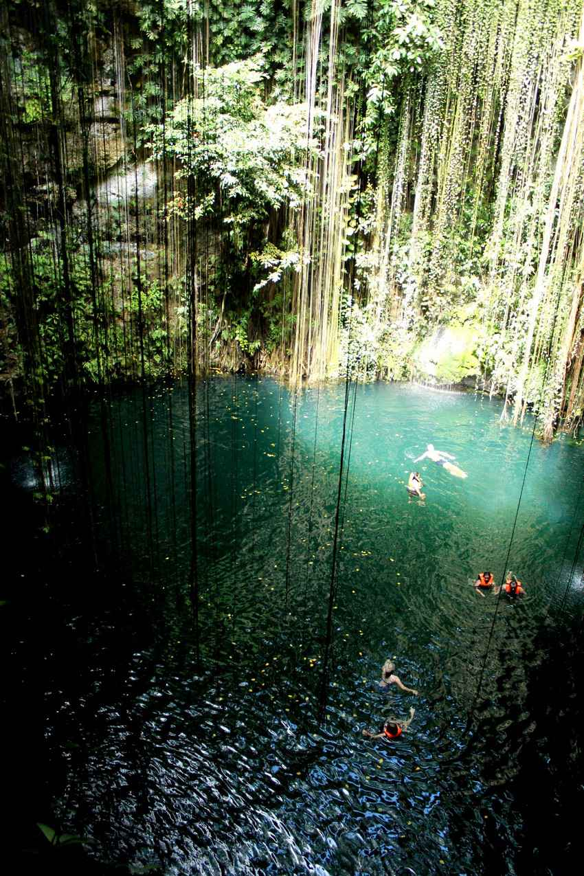 Several visitors swimming in a cenote near Playa Del Carmen.