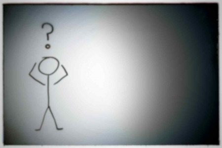 A hand-drawn stick figure with a question mark over its head.