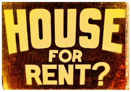 A funky HOUSE FOR RENT sign.