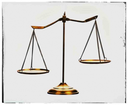 A scale of justice with a white background and frame.