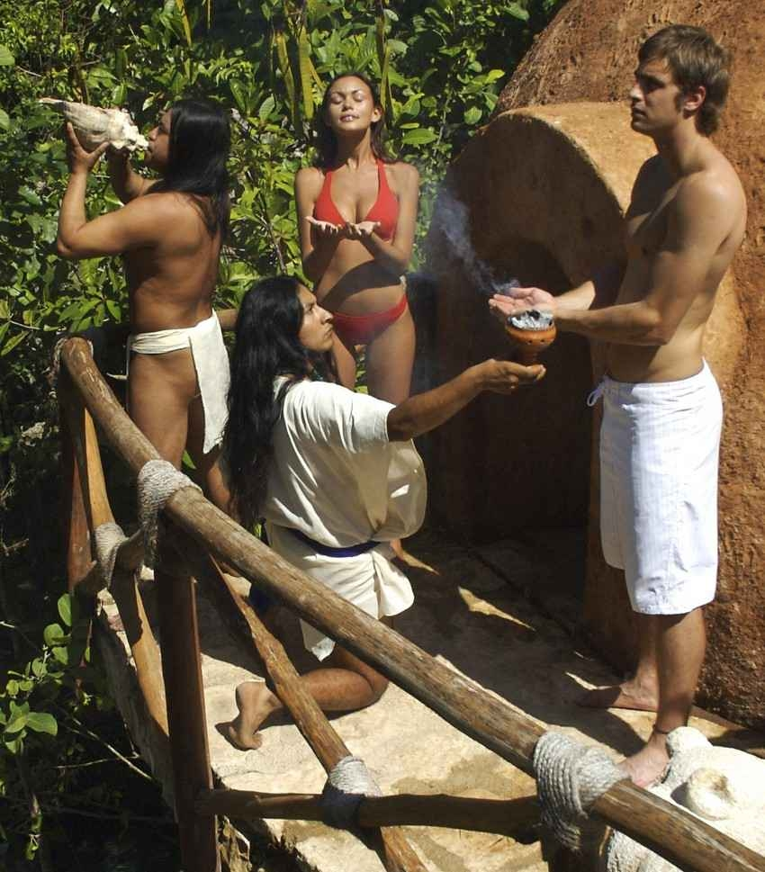 A male tourist and a hot female tourist participating in a Mayan cleansing ceremony.