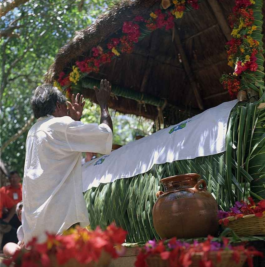 A man performing a Mayan ritual in the jungle.
