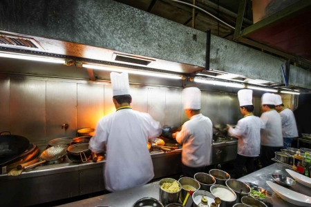 Five chefs working in the kitchen in a popular resort.