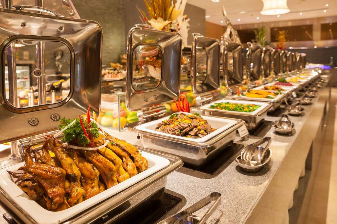An array of many different dinner options at an all-you-can-eat buffet.