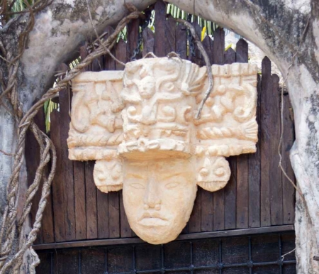 A Mayan warrior headdress sculpture that can be seen above the door of a Playa Del Carmen restaurant.