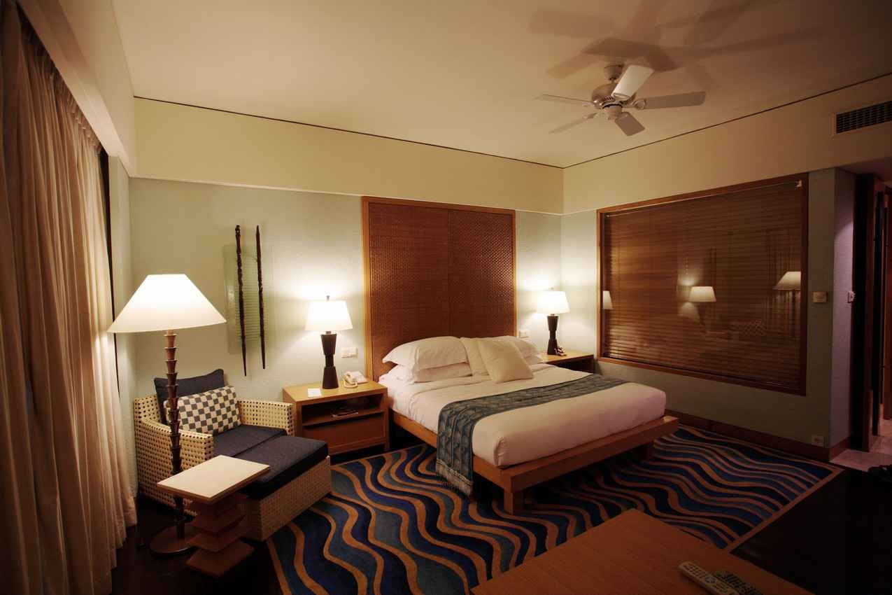 A large and luxurious hotel room.