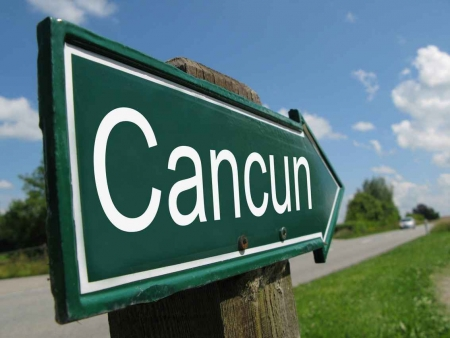 A Cancun signpost near the highway.