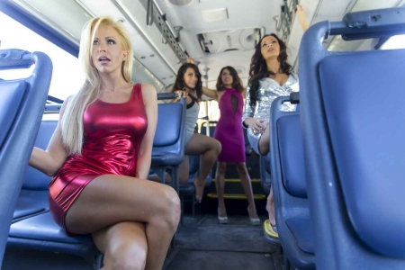 Four supermodels riding on a bus.
