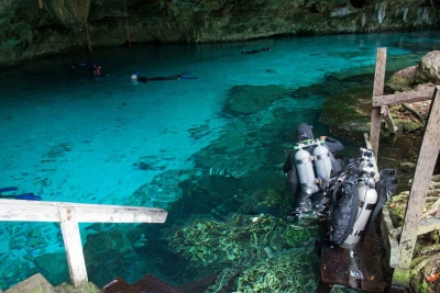 Several scuba divers preparing for a dive inside of a local cenote.