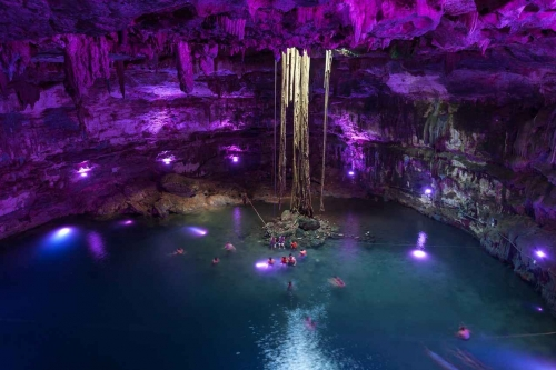Inside a cenote with amazing artificial lighting.