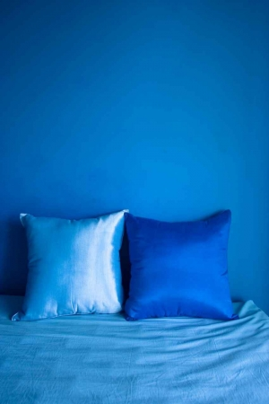 Several decorative pillows on a bed.
