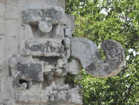 A strange and scary Mayan face on the side of the ruins at Chichen Itza.
