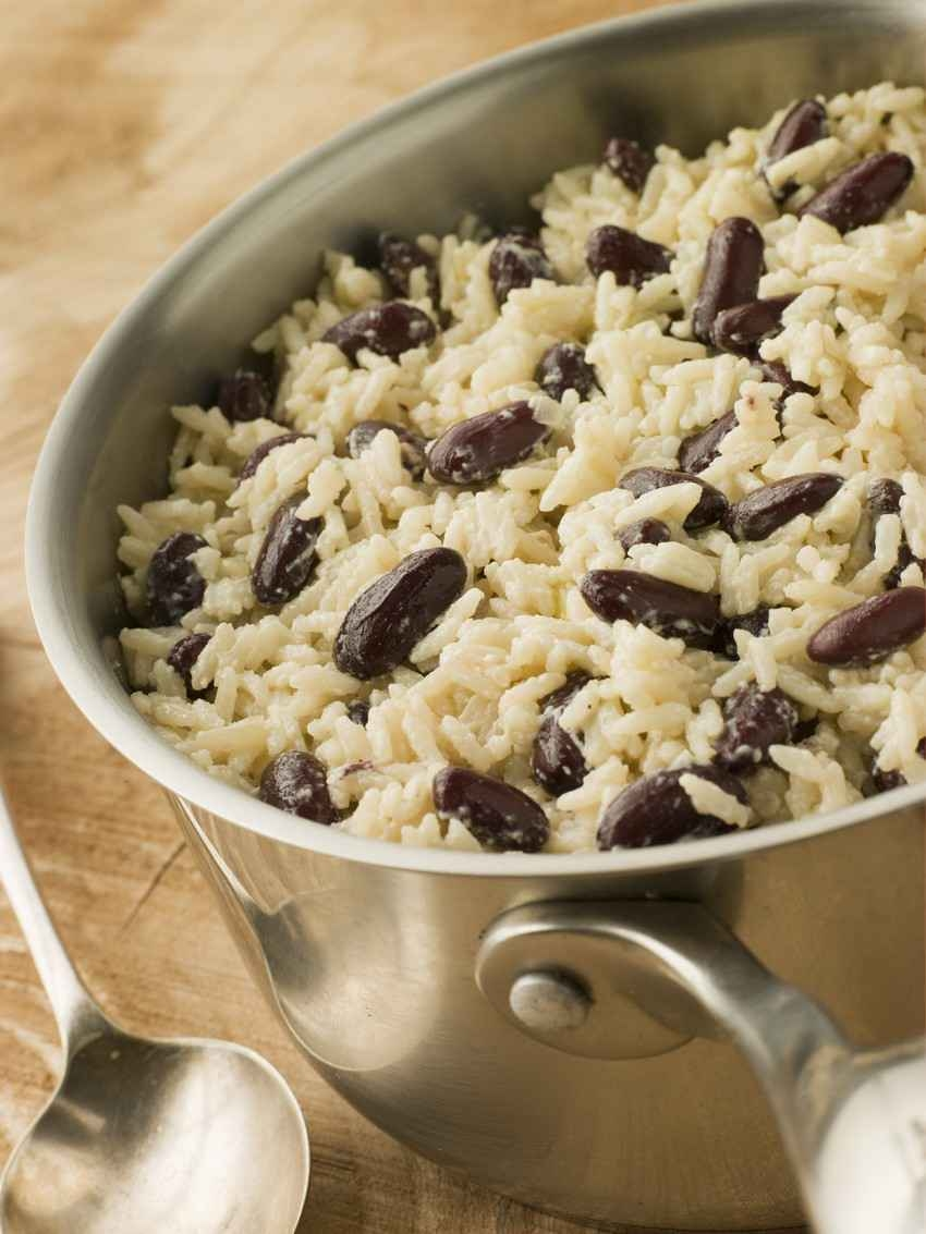 Delicious rice and beans cooking in a stainless steel pot.
