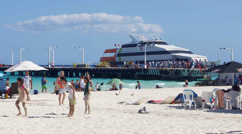 A ferry boat docked near the Playa Del Carmen beach.