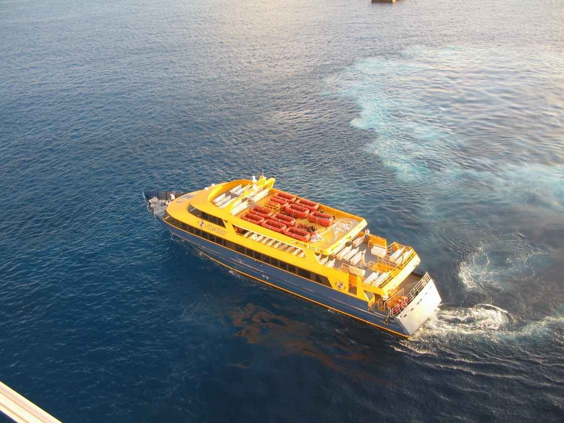 An aerial view of a ferry boat in the water near Playa Del Carmen.