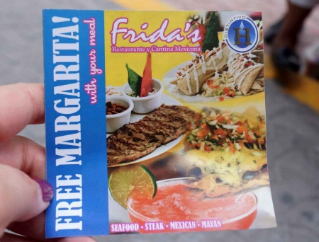 A coupon offering a free margarita with your meal at a Frida's restaurant.