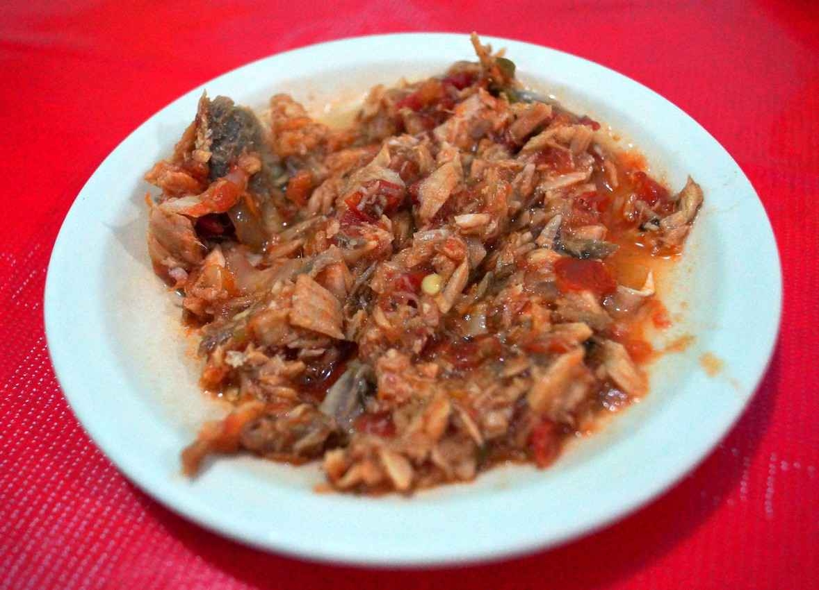 A mix of shredded pork ready to be inserted into tortillas.
