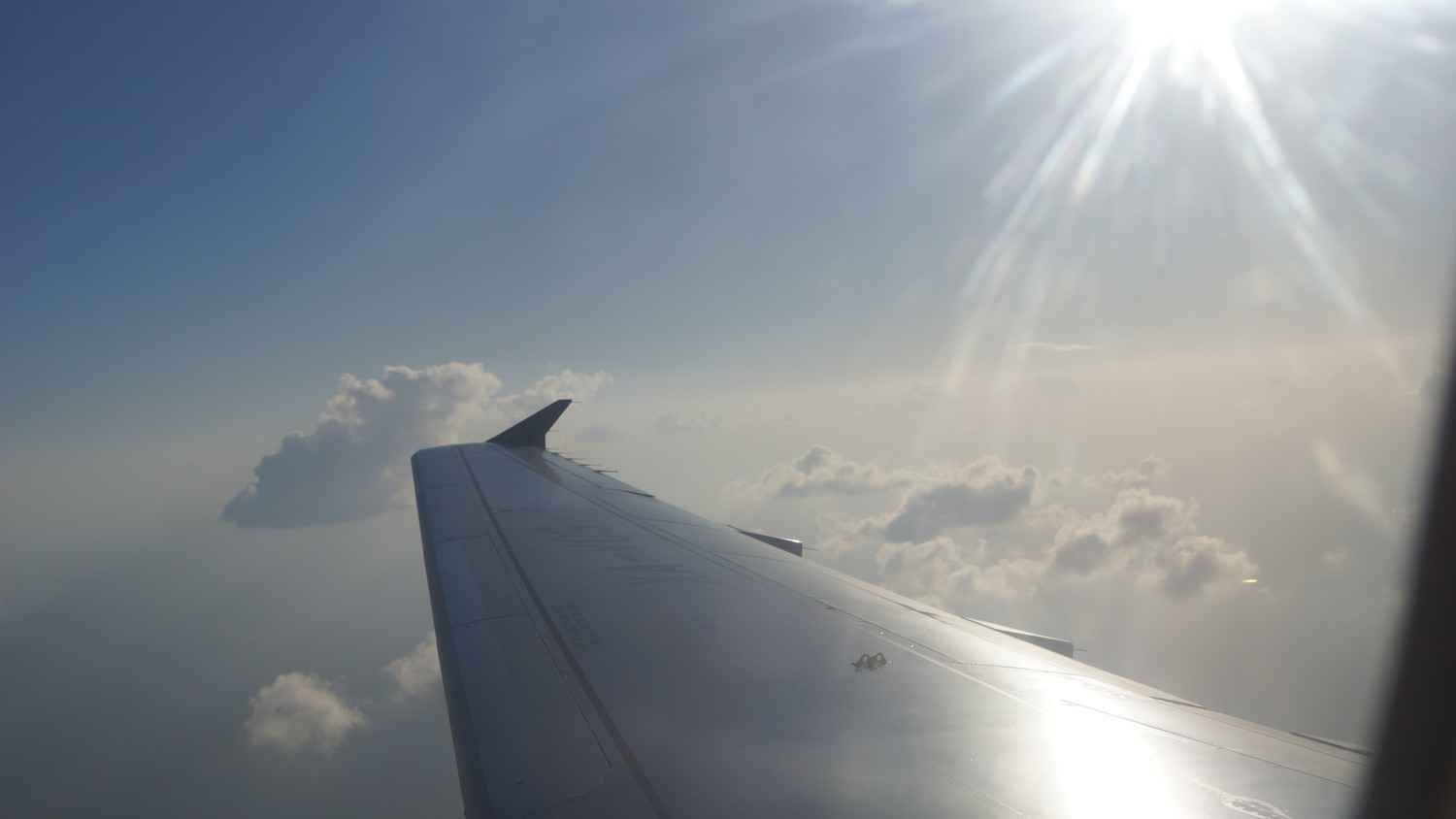 Looking out the window of a jet in transit to Cancun.