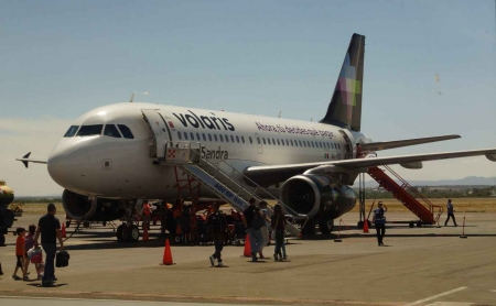 A midsized jet at a Mexican airport.
