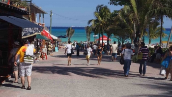 A central street that runs directly into the beach in Playa Del Carmen.