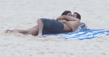 A man and a woman who were kissing on the beach in Playa Del Carmen.