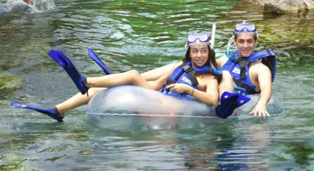 Several honeymooners riding a tube at Xel-Ha themepark.