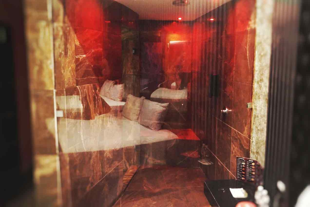An amazing shower with sexy red lights inside of a honeymoon suite in Playa Del Carmen.