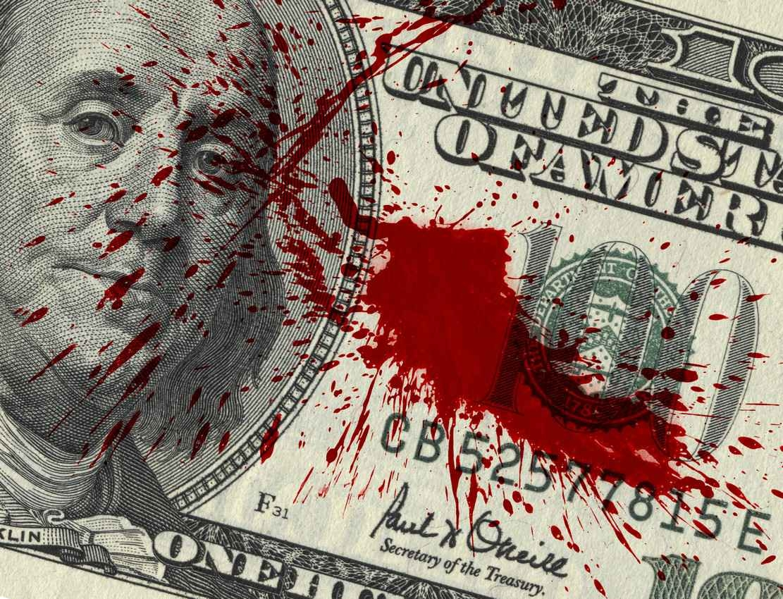 A $100 bill with blood on it.