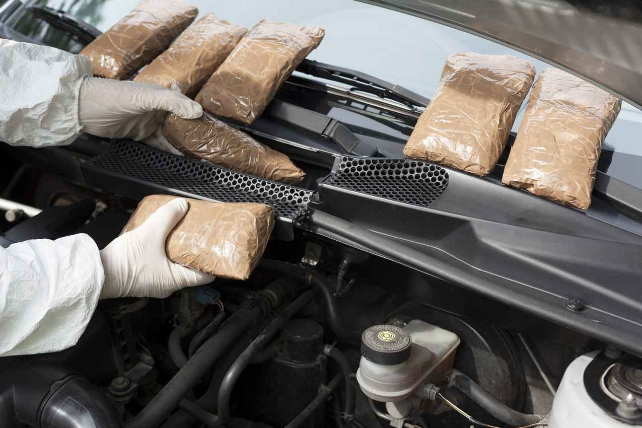 Several bags of drugs hidden in an automobile.