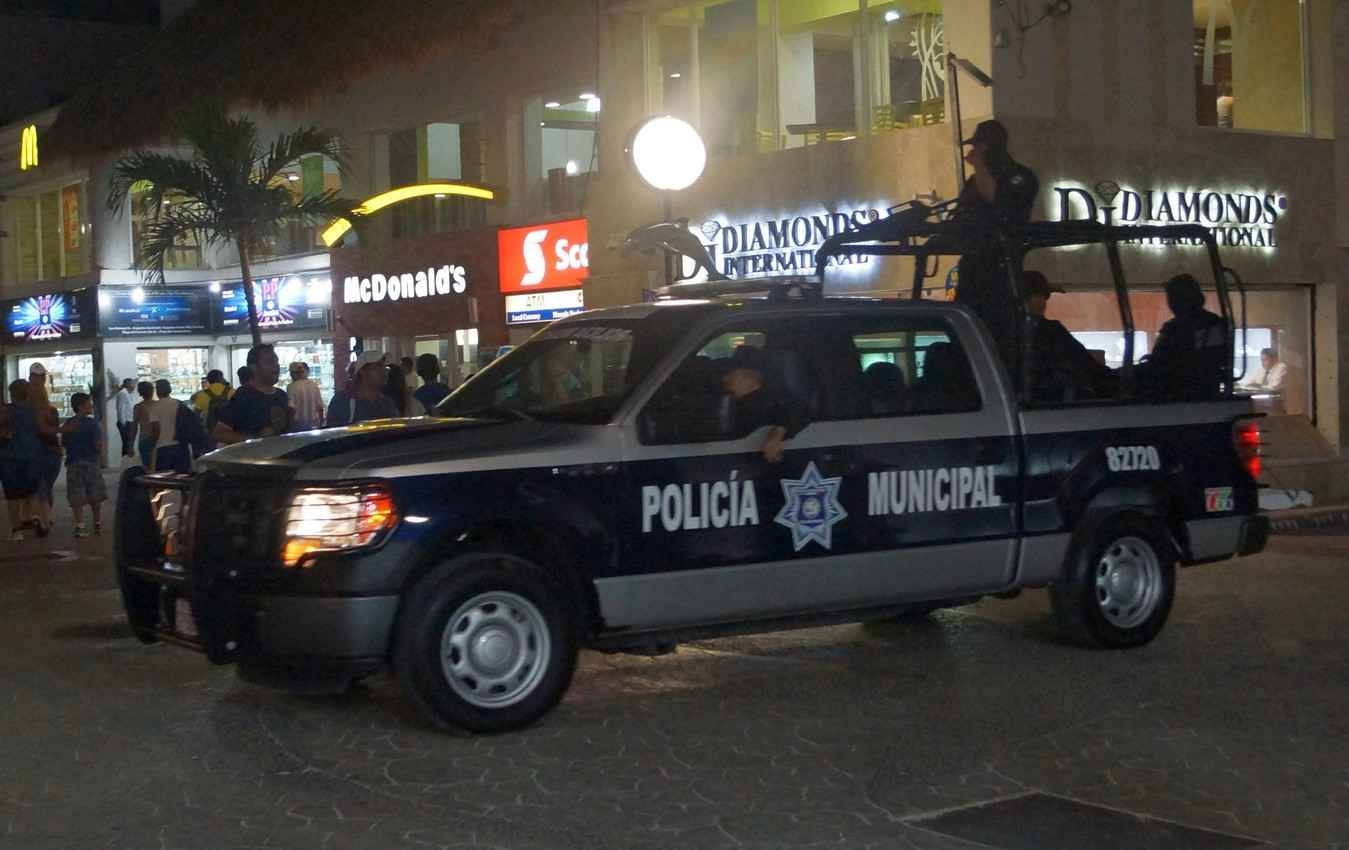 The municipal city police driving through downtown Playa Del Carmen.