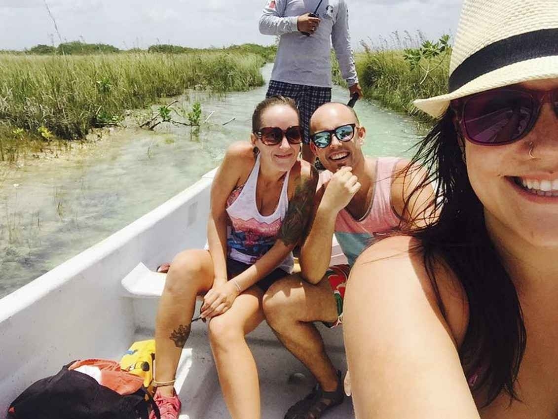 Jasmin and Matt in boat taking a swamp tour.